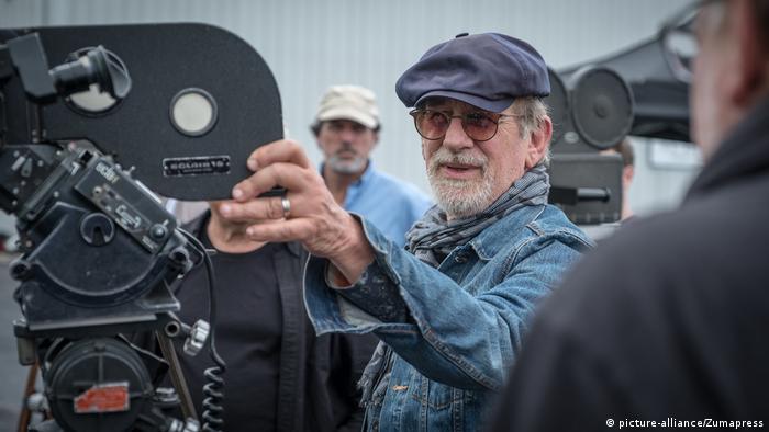 Director Steven Spielberg inspects film cameras on a movie set