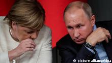 German Chancellor Angela Merkel speaks to Russian President Vladimir Putin