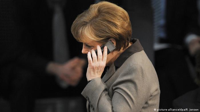 Angela Merkel talks on the phone