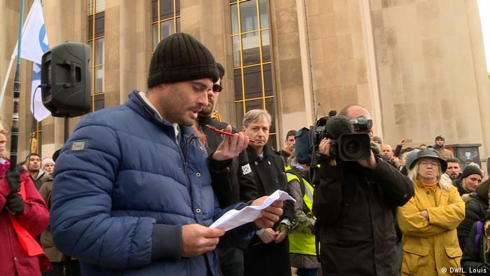 Police officer Guillaume Lebeau holds a speech at a march