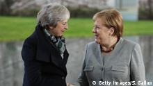 BERLIN, GERMANY - DECEMBER 11: German Chancellor Angela Merkel greets British Prime Minister Theresa May upon May's arrival for talks at the Chancellery on December 11, 2018 in Berlin, Germany. May is meeting Merkel ahead of Thursday's EU Council meeting in Brussels and following May's recent postponement of a vote over her Brexit plan in the British Parliament. May postponed the vote when it became clear she would lose. She is now seeking to wring out extra concessions from EU leaders in order to gain the necessary votes she still needs. (Photo by Sean Gallup/Getty Images)