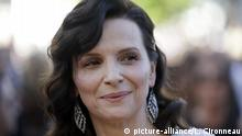 FILE - In this Friday, May 20, 2016, file photo actress Juliette Binoche poses for photographers upon arrival at the screening of the film The Last Face at the 69th international film festival, in Cannes. Juliette Binoche will chair the jury at the 2019 Berlin International Film Festival. (AP Photo/Lionel Cironneau) |