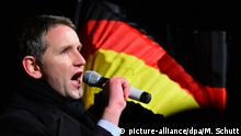 Björn Höcke, the leader of the AfD in Thuringia, speaks in front of a German flag (picture-alliance/dpa/M. Schutt)
