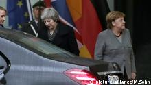 Theresa May, left, leaves after a meeting with German Chancellor Angela Merkel, right, in the chancellery in Berlin, Germany (picture-alliance/M.Sohn)