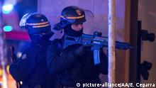French police officers stand guard next to shooting site at the Christmas Market in Strasbourg