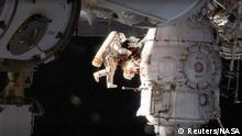 Russian cosmonaut Oleg Kononenko conducts a spacewalk outside the International Space Station Space (ISS) in this still image captured from NASA video in space, December 11, 2018. Courtesy NASA TV/Handout via REUTERS ATTENTION EDITORS - THIS IMAGE HAS BEEN SUPPLIED BY A THIRD PARTY.