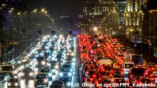 Cars slowly move along a bridge in traffic jam in central Moscow on December 11, 2018. (Photo by Yuri KADOBNOV / AFP) (Photo credit should read YURI KADOBNOV/AFP/Getty Images)
