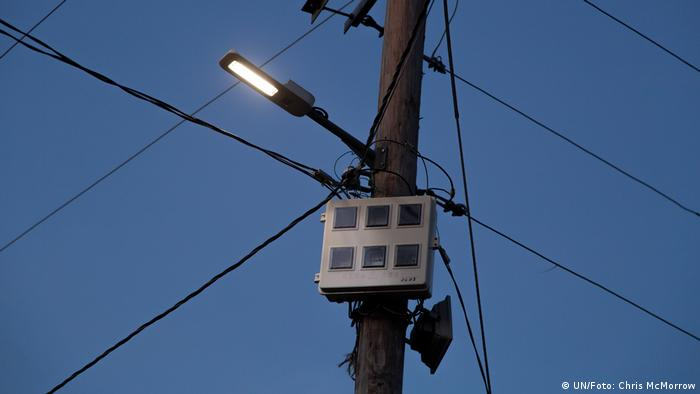 A network of cables and a lamp on a telegraph pole