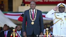 Kenya's President Uhuru Kenyatta, center, attends a ceremony to mark Jamhuri (Republic) Day at Kasarani stadium on the outskirts of Nairobi, Kenya, Tuesday, Dec. 12, 2017. Jamhuri Day marks the date when the country gained independence from the United Kingdom in 1963. (AP Photo/Brian Inganga) |