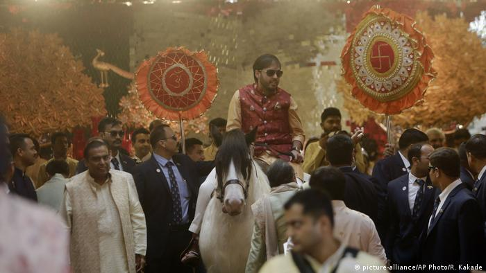 The brother of the bride arrived at the wedding on a traditional white horse