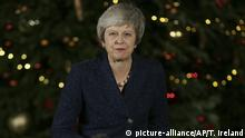 British Prime Minister Theresa May turns to walk back into 10 Downing Street after making a statement, in London, Wednesday December 12, 2018. British Prime Minister Theresa May survived a brush with political mortality Wednesday, winning a no-confidence vote of her Conservative lawmakers that would have ended her leadership of party and country. (AP Photo/Tim Ireland)  