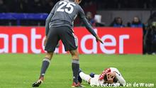 Soccer Football - Champions League - Group Stage - Group E - Ajax Amsterdam v Bayern Munich - Johan Cruijff Arena, Amsterdam, Netherlands - December 12, 2018 Ajax's Nicolas Tagliafico down injured after he is fouled by Bayern Munich's Thomas Mueller REUTERS/Piroschka van de Wouw