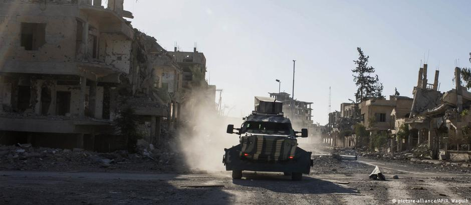 An armored vehicle drives through the city of Raqqa, Syria after the Kurdish-led SDF drove out the 'Islamic State' militant group from its de facto capital