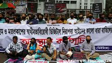 FILE PHOTO: Journalists hold banners and placards as they protest against the newly passed Digital Security Act in front of the Press Club in Dhaka, Bangladesh, October 11, 2018. To match INSIGHT BANGLADESH-ELECTION/MEDIA REUTERS/Mohammad Ponir Hossain/File Photo