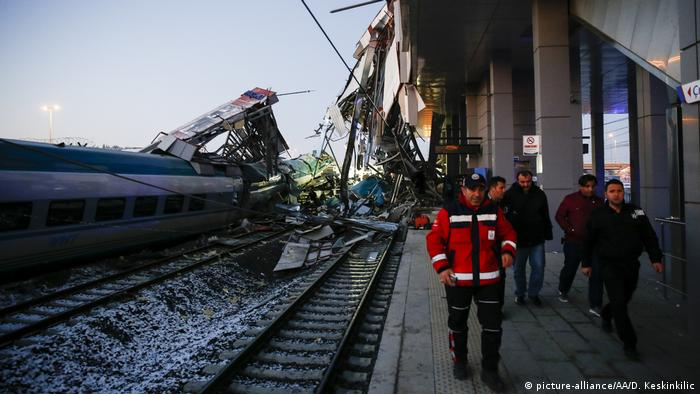 Rescue workers evacuate injured passengers after a high-speed train crashed in the Turkish capital, Ankara