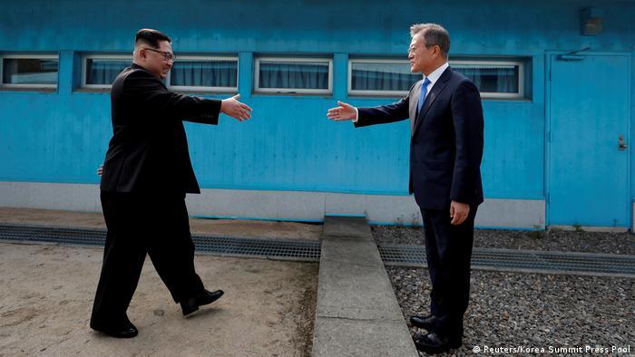 Moon Jae-in shakes hands with Kim Jong Un (Reuters)