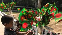 Bangladesh correspondence Harun Ur Rashid. He has allowed us to use this photo. December is the month of Bangladesh's victory. Everywhere this is celebrated by using national flag. People try to use every attire related with color and theme of national flag. Few moments of it.