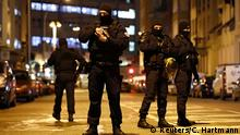 Masked French police officers in Strasbourg's Meinau neighborhood on Thursday evening (Reuters/C. Hartmann)