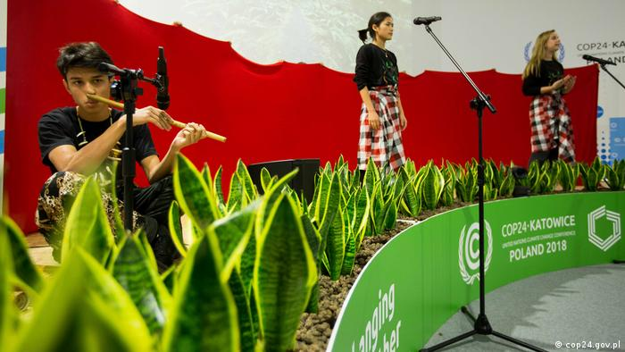 Young people performing on makeshift stage