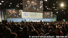 Audience listening to discussion on podium at the Katowice climate summit (picture-alliance/dpa/C. Sokolowski)