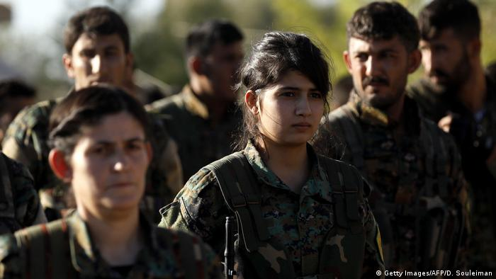 Fighters from the Syrian Democratic Forces (SDF) attend the funeral of one of their commanders