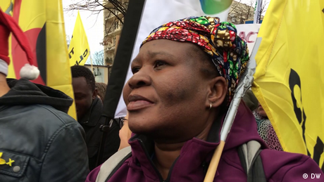 Photo of Makoma Lekalakala at a protest holding a yellow banner