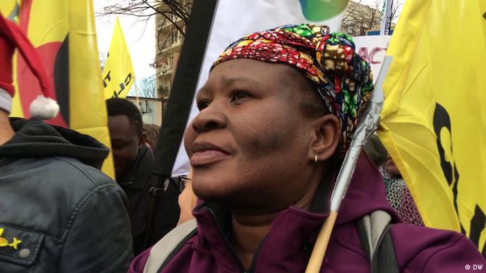 Photo of Makoma Lekalakala at a protest holding a yellow banner