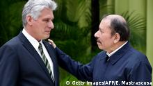 Cuban President Miguel Diaz-Canel (L) speaks with Nicaraguan President Daniel Ortega (R) upon his arrival for the XVI Summit of the Bolivarian Alliance for the People of Our Americas (ALBA) in Havana, on December 14, 2018. - ALBA countries are seeking to strengthen their ties to face US pressures and the advance of right wing governments in Latin America. (Photo by Ernesto MASTRASCUSA / POOL / AFP) (Photo credit should read ERNESTO MASTRASCUSA/AFP/Getty Images)