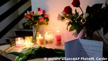 Flowers and candles placed on a table in the apartment building where Sarah Papenheim lived