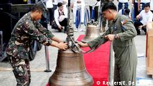 Philippine Air Force personnel unload the church bells onto a red carpet (Reuters/E. De Castro)