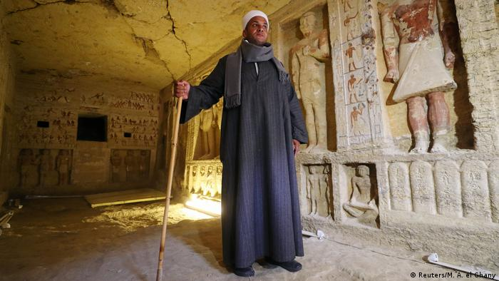 Excavation chief Mustafa Abdo stands inside the newly-discovered, 4,400-year-old tomb of Wahtye in Egypt (Reuters/M. A. el Ghany)