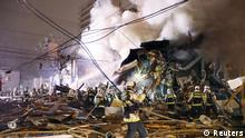 Firefighters at the site where a large explosion occurred at a restaurant in Sapporo, Hokkaido (Reuters)