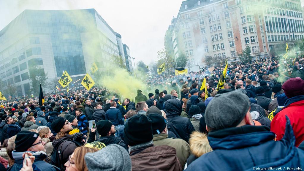 Tear gas, dozens of arrests at Brussels anti-migration demo