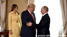 July 16, 2018 - Moscow, Russia - Russian President Vladimir Putin, right, greets U.S. President Donald Trump as First Lady Melania Trump looks on at the start of a Summit Meeting between the two nations at the Presidential Palace July 16, 2018 in Helsinki, Finland  