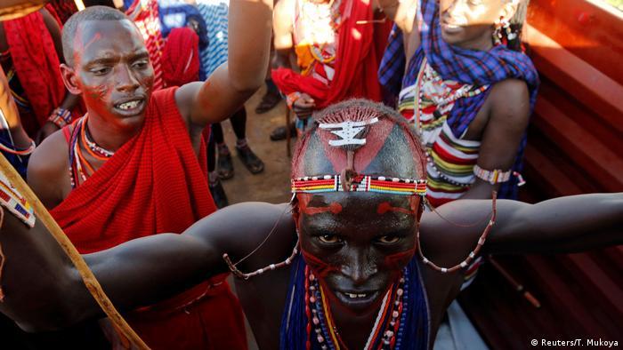 Maasai moran riding in truck (Reuters/T. Mukoya)