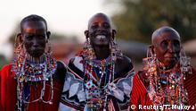 Maasai women sing and dance at sunset at the Mbirikani Manyatta at the base of Mt. Kilimanjaro, near the Kenya-Tanzania border in Kimana, Kajiado, Kenya December 14, 2018. Picture taken December 14, 2018. REUTERS/Thomas Mukoya