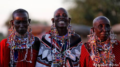 Three Maasai women wearing traditional jewellery and blankets (Reuters/T. Mukoya)