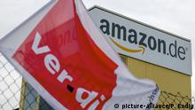 A Verdi union flag flies outside of an Amazon building in Germany (picture-alliance/P. Endig)