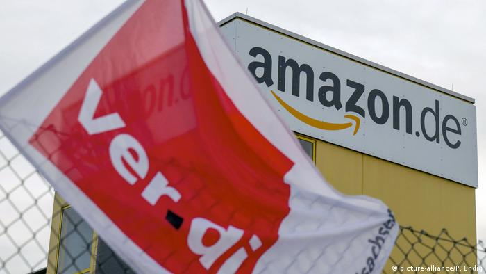 A Verdi union flag flies outside of an Amazon building in Germany