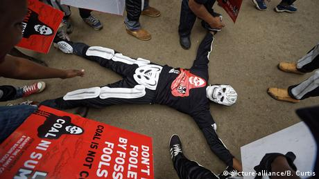 A protesters dressed in a skeleton costume demonstrates against the Lamu power plant
