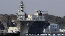 Japanese helicopter carrier Izumo sits in port