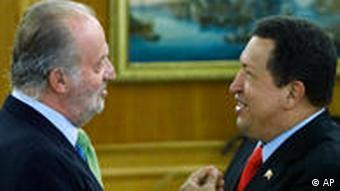 Spain's King Juan Carlos, left and Venezuelan President Hugo Chavez