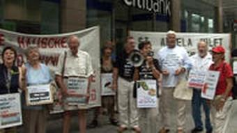 Seniors and retirees demonstrate outside a Citibank branch in Germany