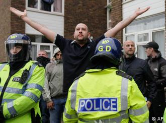 British police officers control anti-Muslim demonstraors gesturing and chanting towards Muslim protesters in the London suburb of Harrow