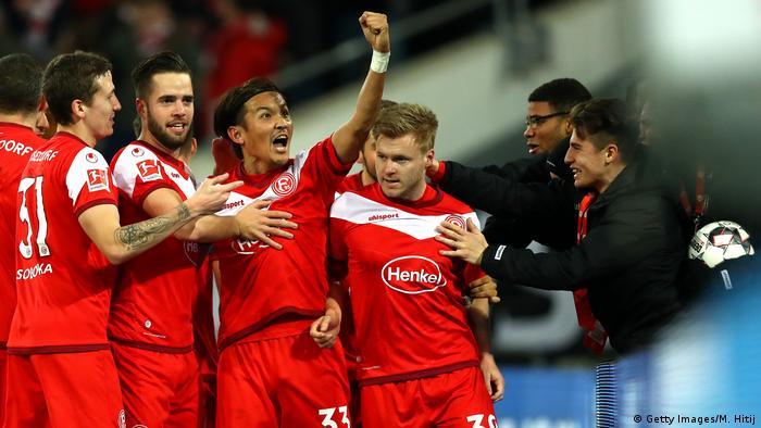 Borussia Dortmund suffer first Bundesliga defeat away at Fortuna ...