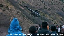 An image grab taken from a video broadcast in Morocco's news channel KECH24 on December 18, 2018 shows a helicopter at the scene of a crime where the bodies of two Scandinavian women were found the day before in an isolated mountainous area 10 kilometres (six miles) from the tourist village of Imlil in the High Atlas range. - Moroccan authorities on December 18, 2018 arrested a suspect following the murder of a Danish and Norwegian hiker, who were found dead with cuts to their necks, the interior ministry said. Imlil is a starting point for trekking and climbing tours of Mount Toubkal, which at 4,167 metres is the highest summit in North Africa. (Photo by - / KECH24 Moroccan News Channel / AFP) (Photo credit should read -/AFP/Getty Images)