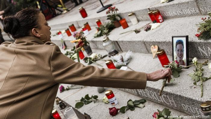 A woman attends to a memorial for the victims of the 2016 Berlin terror attack
