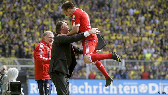 Franck Ribery celebrates with coach Louis van Gaal after scoring against Borussia Dortmund