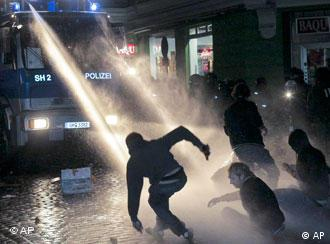 Police use a water cannon in Hamburg