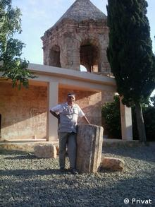 Hanan outside a Yazidi church in his hometown (Privat)
